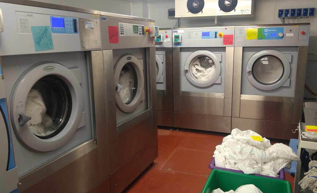 Five Commercial Washing Machines in commercial laundry